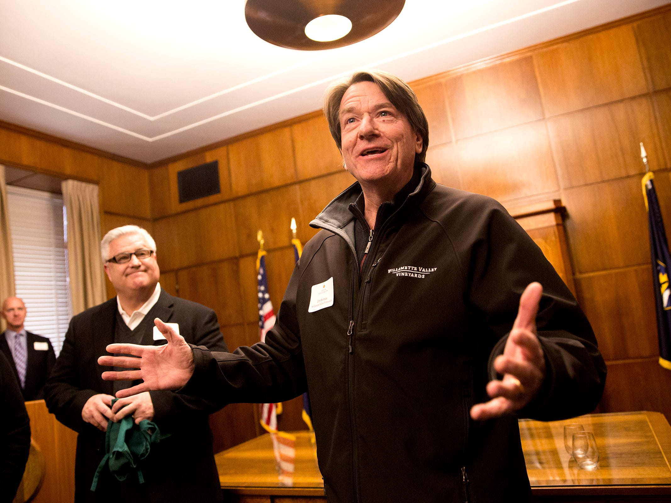 Willamette Valley Vineyard founder and president Jim Bernau speaks at a release party for the Oregon Solidarity Rose of Pinot Noir as Tim Jennings, of Roth's Fresh Markets looks on in Gov. Kate Brown's ceremonial office at the Oregon State Capitol in Salem on Tuesday, March 5, 2019.