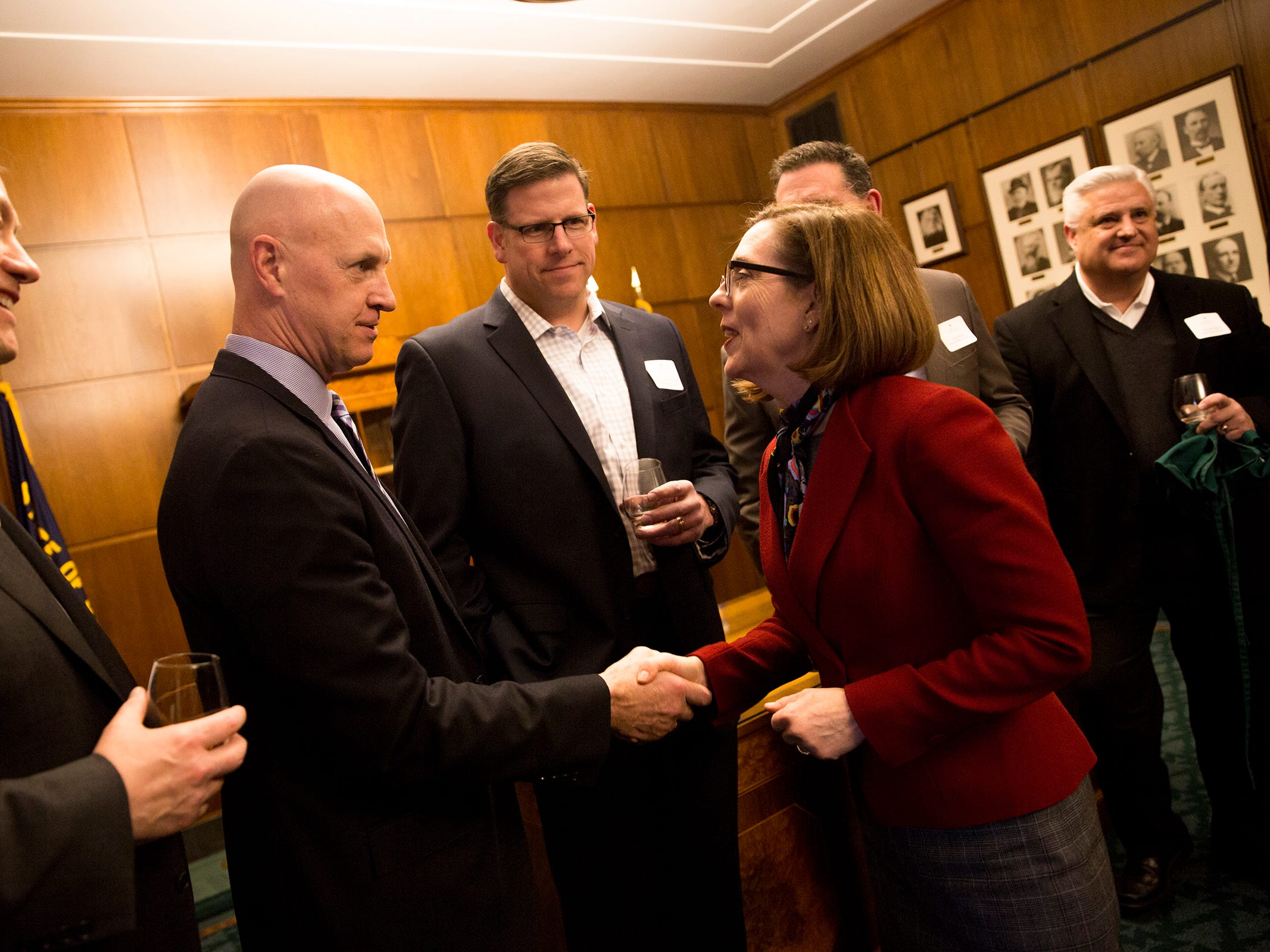 Gov. Kate Brown greets Oregon winery representatives at a release party for the Oregon Solidarity Rose of Pinot Noir in the Gov. Kate Brown's ceremonial office at the Oregon State Capitol in Salem on Tuesday, March 5, 2019.