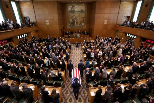 The casket is escorted into the House of Representatives for the state funeral for Secretary of State Dennis Richardson at the Oregon State Capitol in Salem on Wednesday, March 6, 2019.