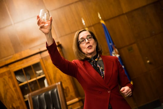 Gov. Kate Brown gives a toast at a release party for the Oregon Solidarity Rose of Pinot Noir in the Governor's ceremonial office at the Oregon State Capitol in Salem on Tuesday, March 5, 2019.