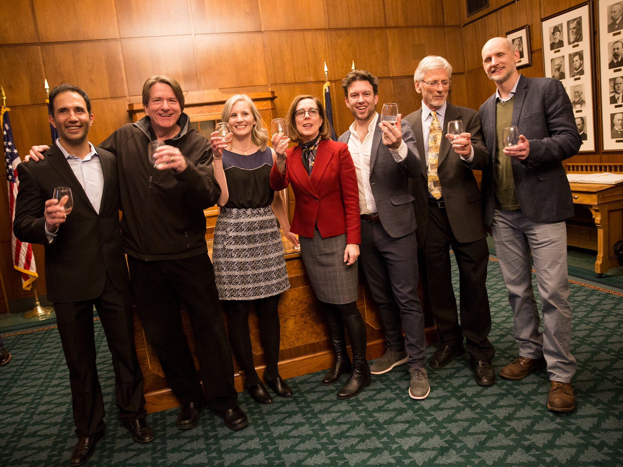 Gov. Kate Brown takes a photo with Oregon winery representatives at a release party for the Oregon Solidarity Rose of Pinot Noir in the Governor's ceremonial office at the Oregon State Capitol in Salem on Tuesday, March 5, 2019.