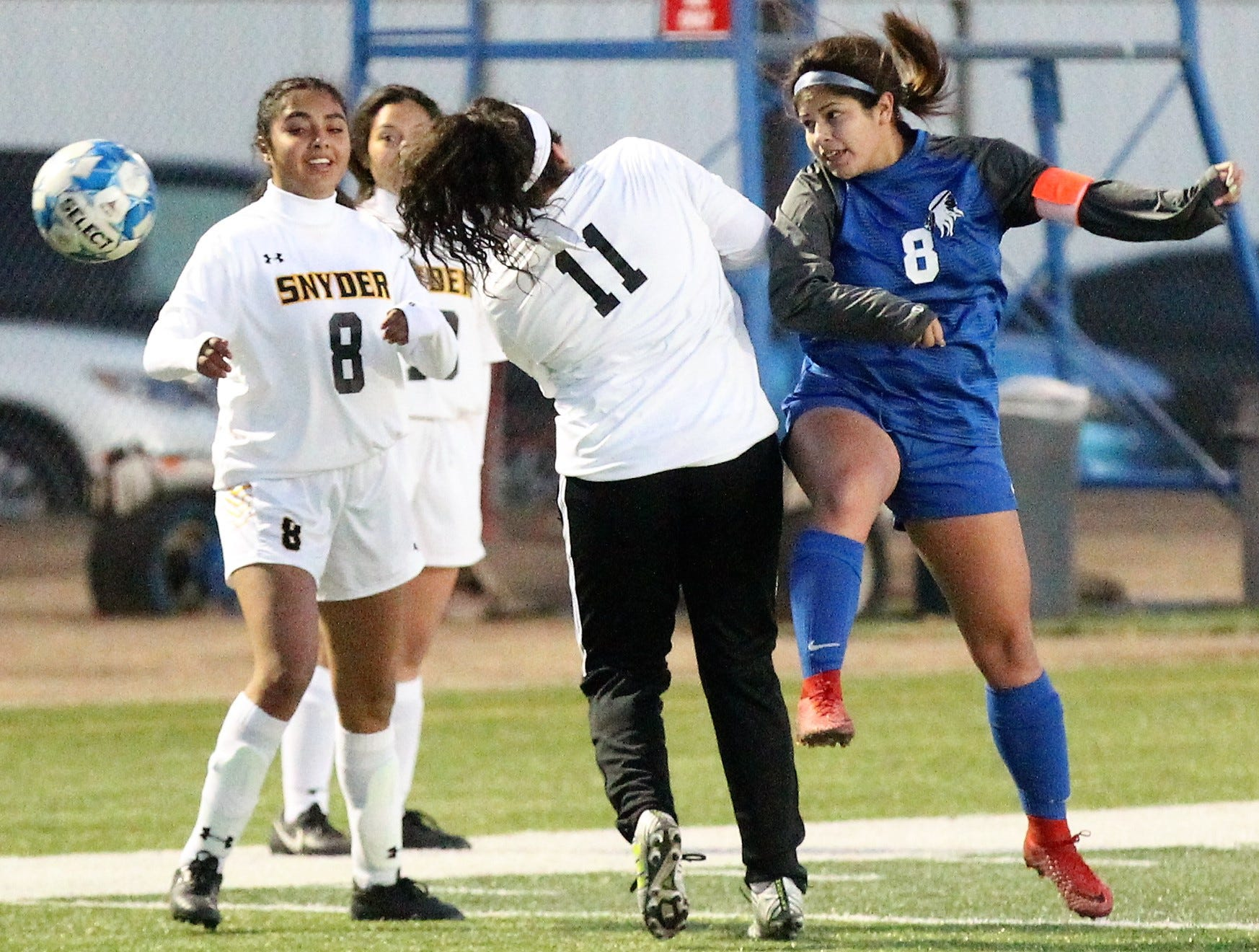 Lake View's Ariana Rangel (right) fights for a header in a District 4-4A soccer match against Snyder at Old Bobcat Stadium on Tuesday, March 5, 2019.