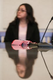 Maria Martinez listens to Alma Perez speak during the naturalization ceremony Wednesday March 6, 2019, at the O.C. Fisher Federal Building.
