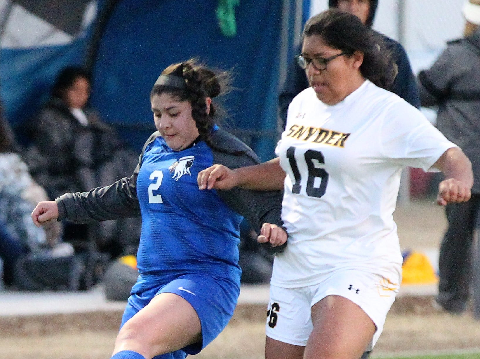 Lake View's Abigail Borrego (left) keeps possession in a District 4-4A soccer match against Snyder at Old Bobcat Stadium on Tuesday, March 5, 2019.