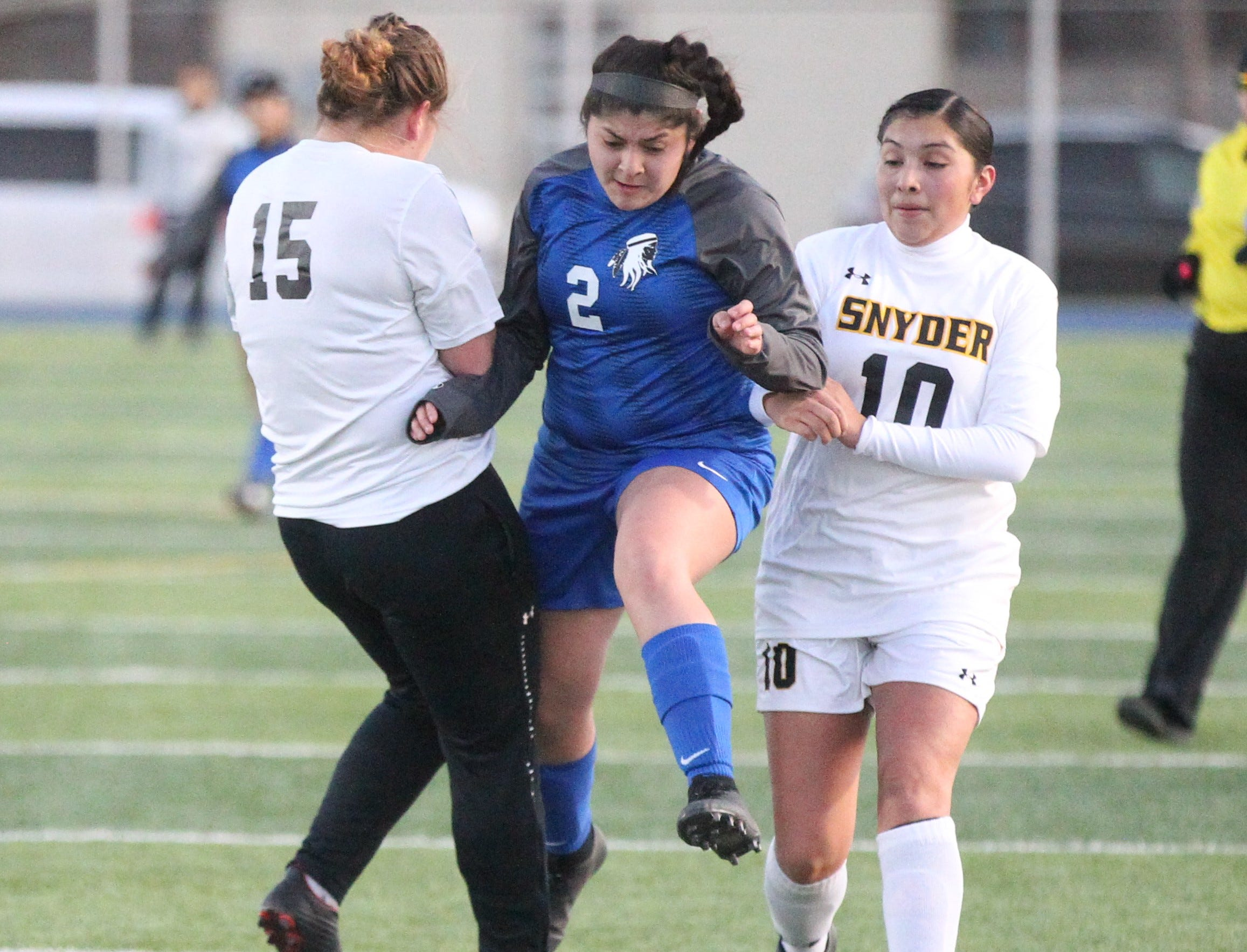 Lake View's Abigail Borrego (2) fights for the ball in a District 4-4A soccer match against Snyder at Old Bobcat Stadium on Tuesday, March 5, 2019.