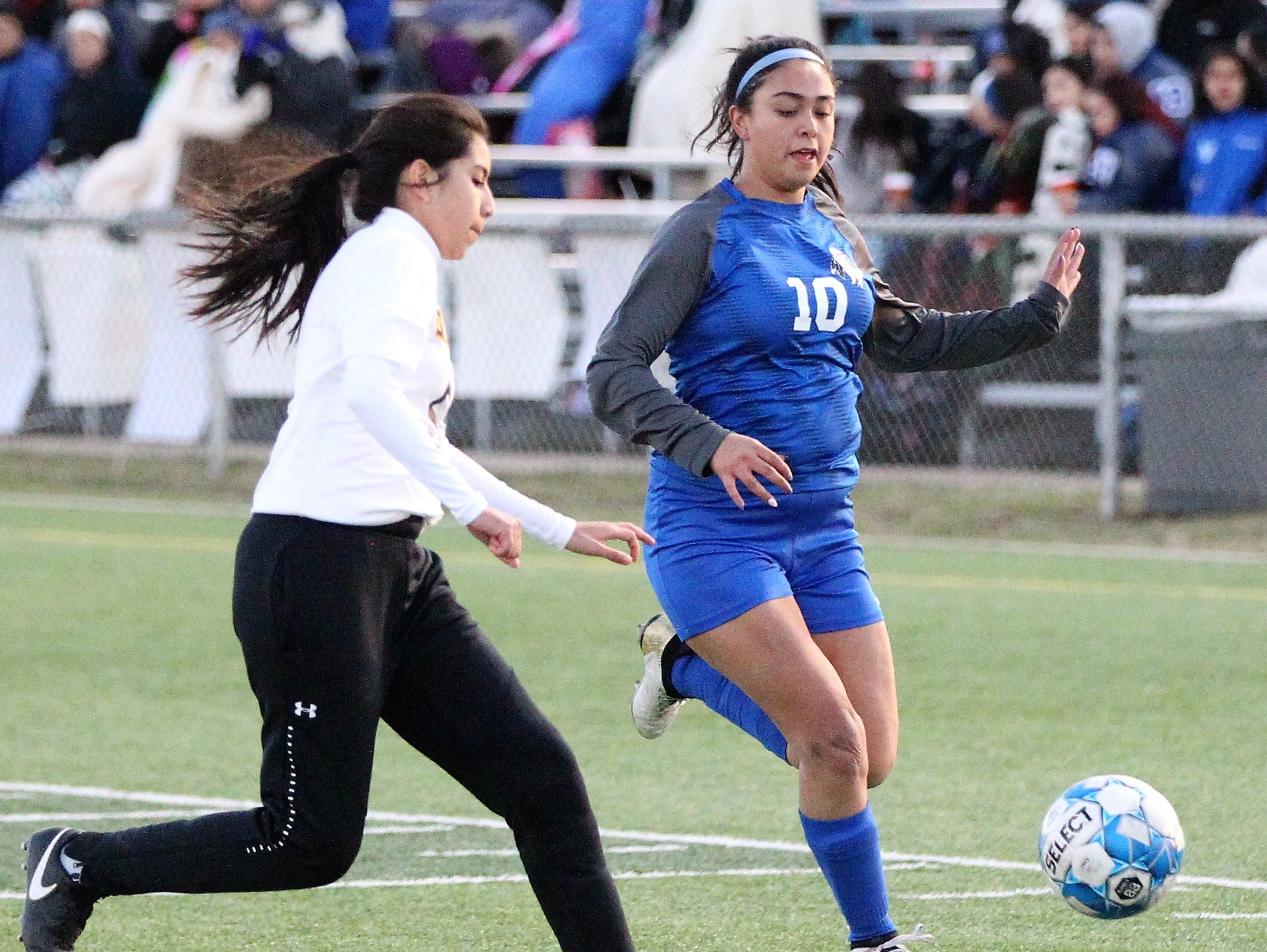 Lake View's Alize Garfias (right) fights for the ball in a District 4-4A soccer match against Snyder at Old Bobcat Stadium on Tuesday, March 5, 2019.