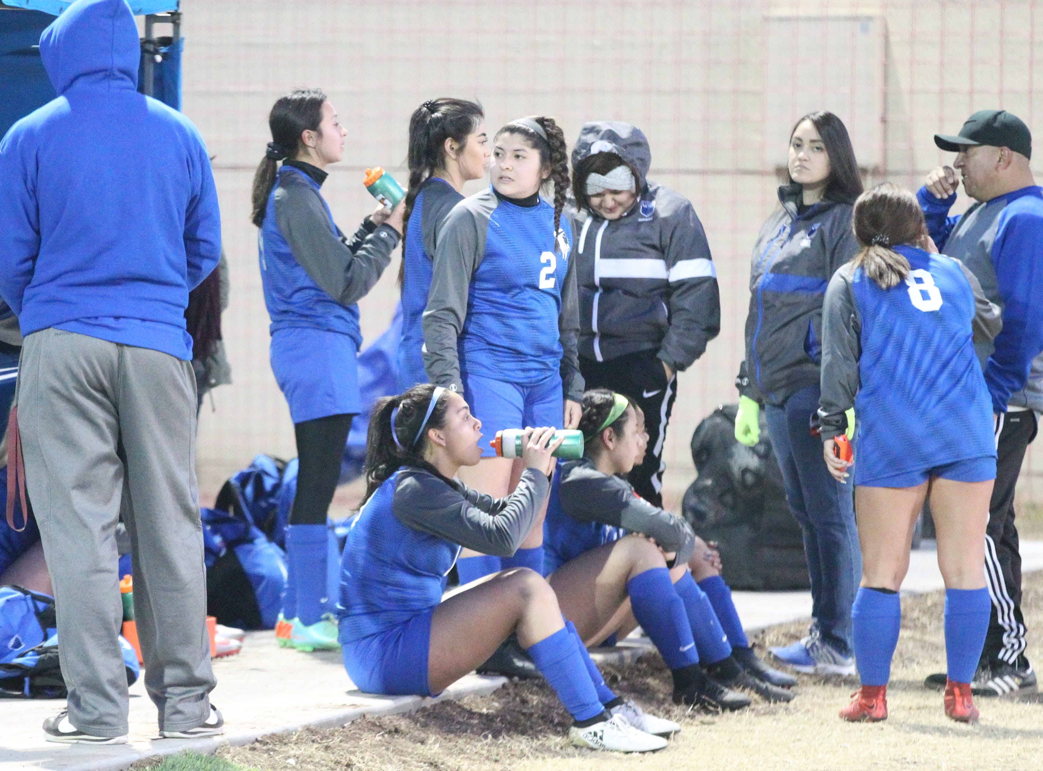 Lake View head coach Henry Gonzales (far right) talks to the Maidens at halftime of a District 4-4A soccer match against Snyder at Old Bobcat Stadium on Tuesday, March 5, 2019.