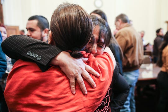 Teresa Santos hugs Alma Perez after the naturalization ceremony Wednesday March 6, 2019, at the O.C. Fisher Federal Building.