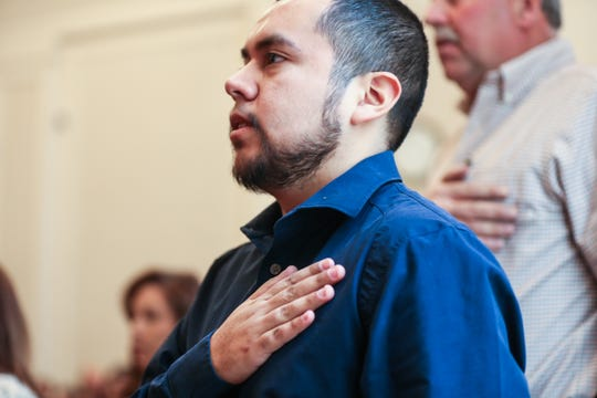 Jose Ismael Reyes Garcia says the pledge of allegiance during the naturalization ceremony Wednesday March 6, 2019, at the O.C. Fisher Federal Building.