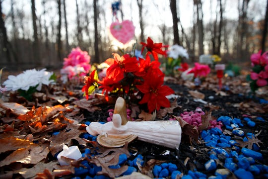 In this Jan. 28 photo, a statue of an angel rests on Anton Black's gravesite in a cemetery in Kent County, Md.