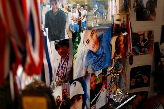In this Jan. 28 photo, pictures of Anton Black decorate a collage in his family's home in Greensboro, Md.