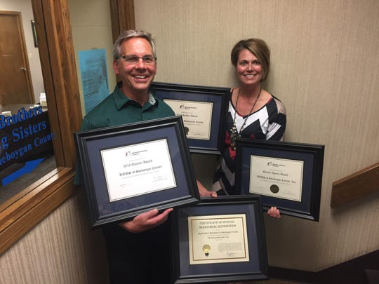Newly elected Board Chair Brian Jenny of Big Brothers Big Sisters of Sheboygan County and Executive Director Denise Wittstock display four consecutive national Quality Awards.