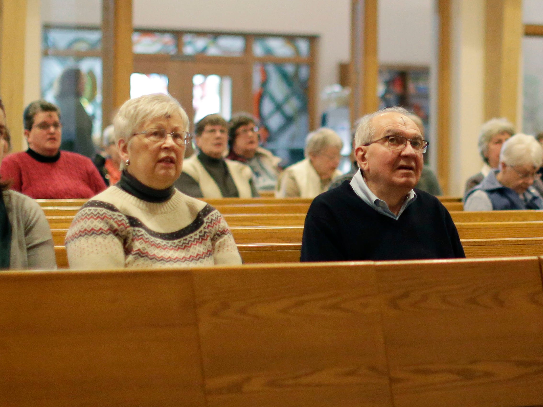 Parishioners at First United Lutheran Church wear ashes in the sign of the cross during Ash Wednesday service, Wednesday, March 6, 2019, in Sheboygan, Wis.