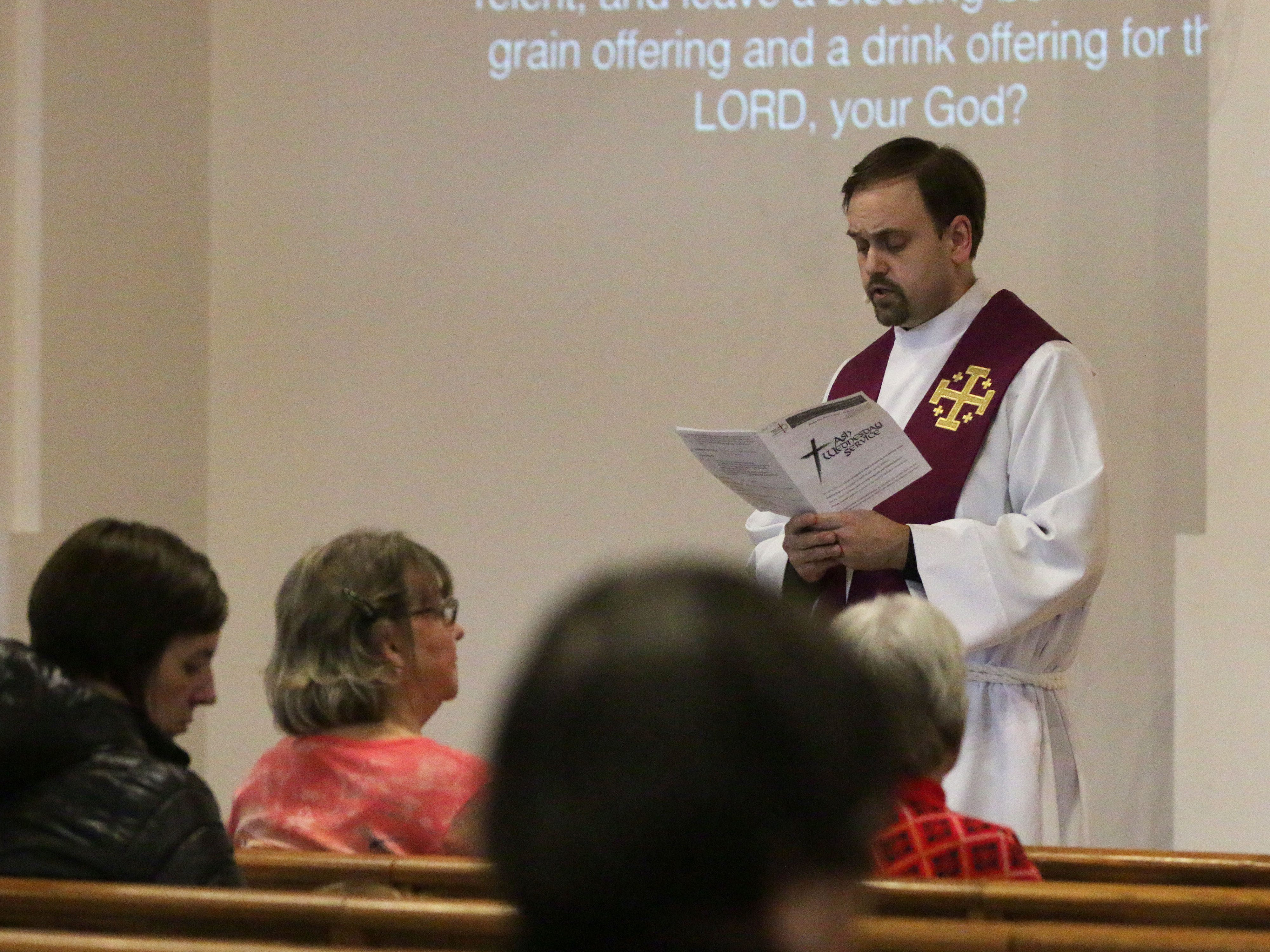 Rev. Matt Hacker reads during Ash Wednesday service at First United Lutheran Church, Wednesday, March 6, 2019, in Sheboygan, Wis.