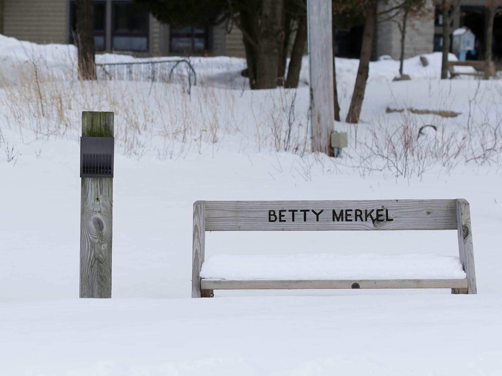 A pair of benches wait for spring at the Ellwood H. May Environmental Park, Tuesday, March 5, 2019, in Sheboygan, Wis.