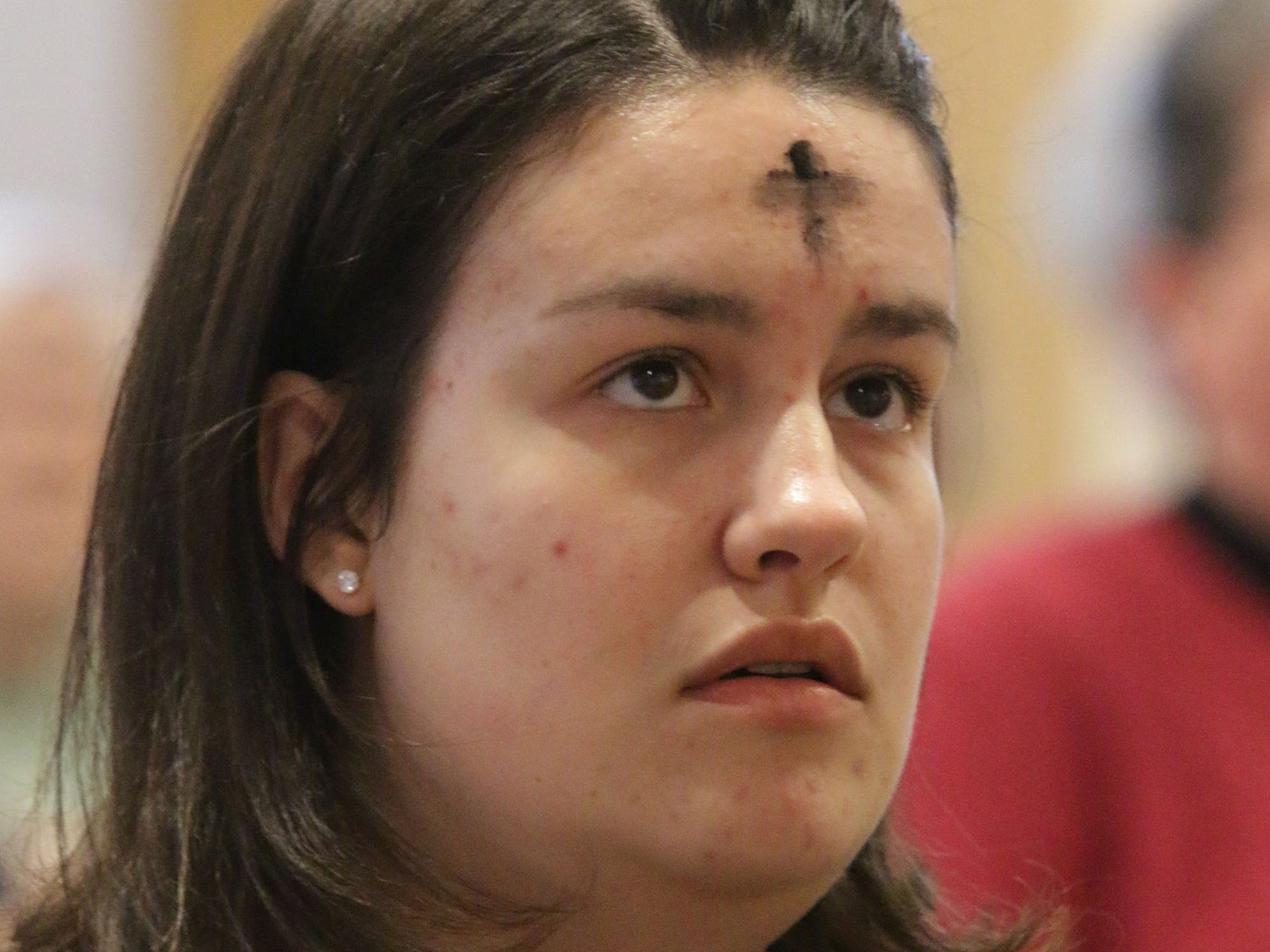 Elena Kieckhafer wears ashes during Ash Wednesday service at First United Lutheran Church, Wednesday, March 6, 2019, in Sheboygan, Wis.