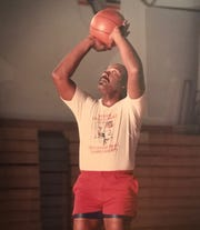 Carl Pierson shooting hoops during his younger years.
