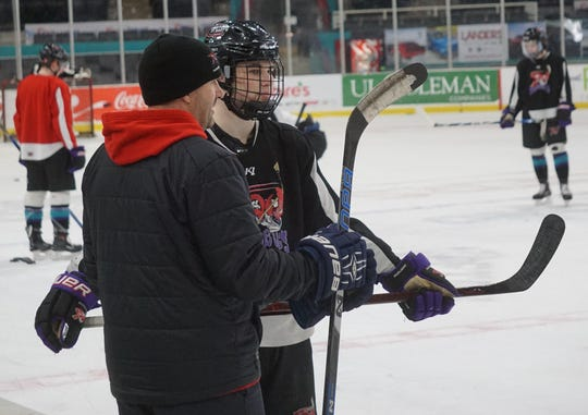 Will Kutch, a prospect for the Shreveport Mudbugs' 2019-20 roster, speaks with head coach Jason Campbell during practice Wednesday.
