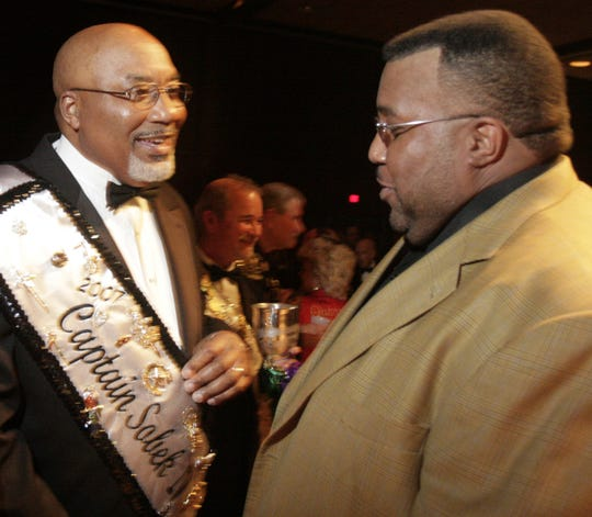 Carl Pierson and Mayor Cedric Glover chat the 12th Night Mardi Gras celebration at the Bossier Civic Center in 2007.