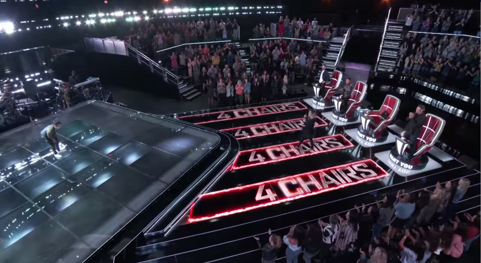 """Kelly Clarkson, a coach on """"The Voice,"""" approaches Jej Vinson after his blind audition in which all four coaches turned their chairs for him. The episode aired on March 5, 2019."""
