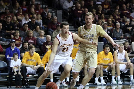 Northern State's Gabe King drives the baseline as Michael Lee of SMSU defends during Tuesday night's NSIC championship game at the Pentagon.