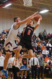 Dell Rapids' Connor Rentz takes a shot against Parker's Trey Christensen during the game Tuesday, March 5, at Roosevelt High School in Sioux Falls. Dell Rapids won 59-31 against Parker to advance to the Class A state tournament.