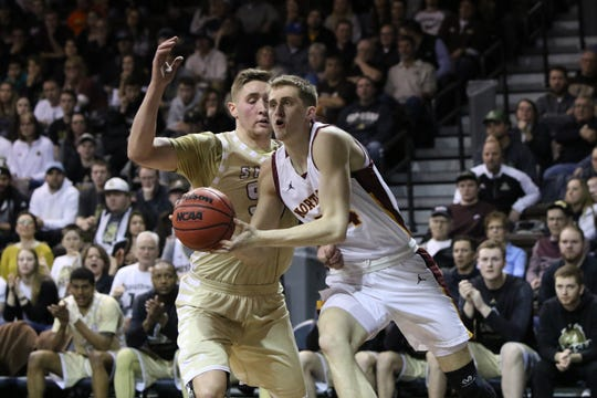 Northern State's Parker Fox gets around Kolin Bartlett of SMSU during Tuesday night's NSIC championship game at the Pentagon.