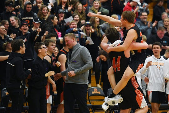 Dell Rapids' Matthew Benda jumps into  Logan Heim's arms after their win against Parker Tuesday, March 5, at Roosevelt High School in Sioux Falls. Dell Rapids won 59-31 against Parker to advance to the Class A state tournament.