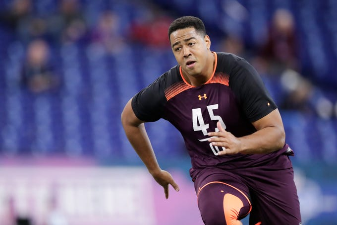 Sioux Falls offensive lineman Trey Pipkins runs a drill at the NFL football scouting combine in Indianapolis, Friday, March 1, 2019.
