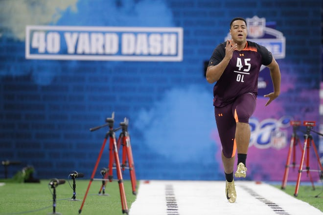 Sioux Falls offensive lineman Trey Pipkins runs the 40-yard dash during the NFL football scouting combine, Friday, March 1, 2019, in Indianapolis.