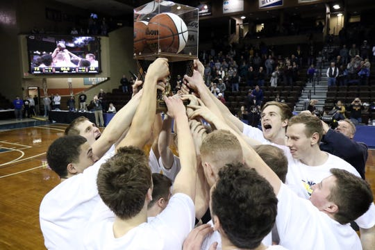 Northern State players celebrate after winning the NSIC tournament over SMSU on Tuesday night at the Pentagon.