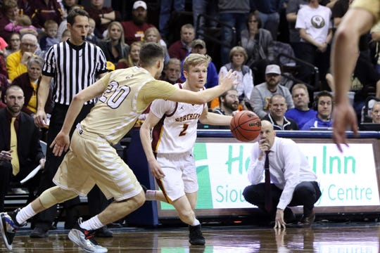 Mason Stark of Northern State attempts to dribble past Taylor Schafer of SMSU during Tuesday night's NSIC championship game at the Pentagon.