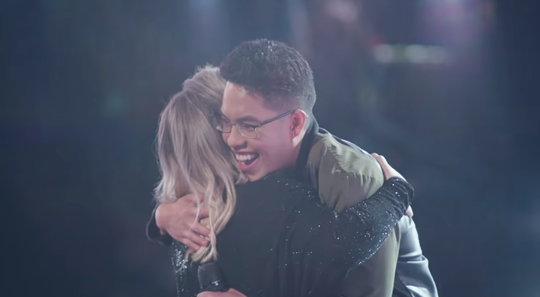 """Jej Vinson hugs Kelly Clarkson, a coach on """"The Voice"""" after his blind audition in which all four coaches turned their chairs for him. The episode aired on March 5, 2019."""