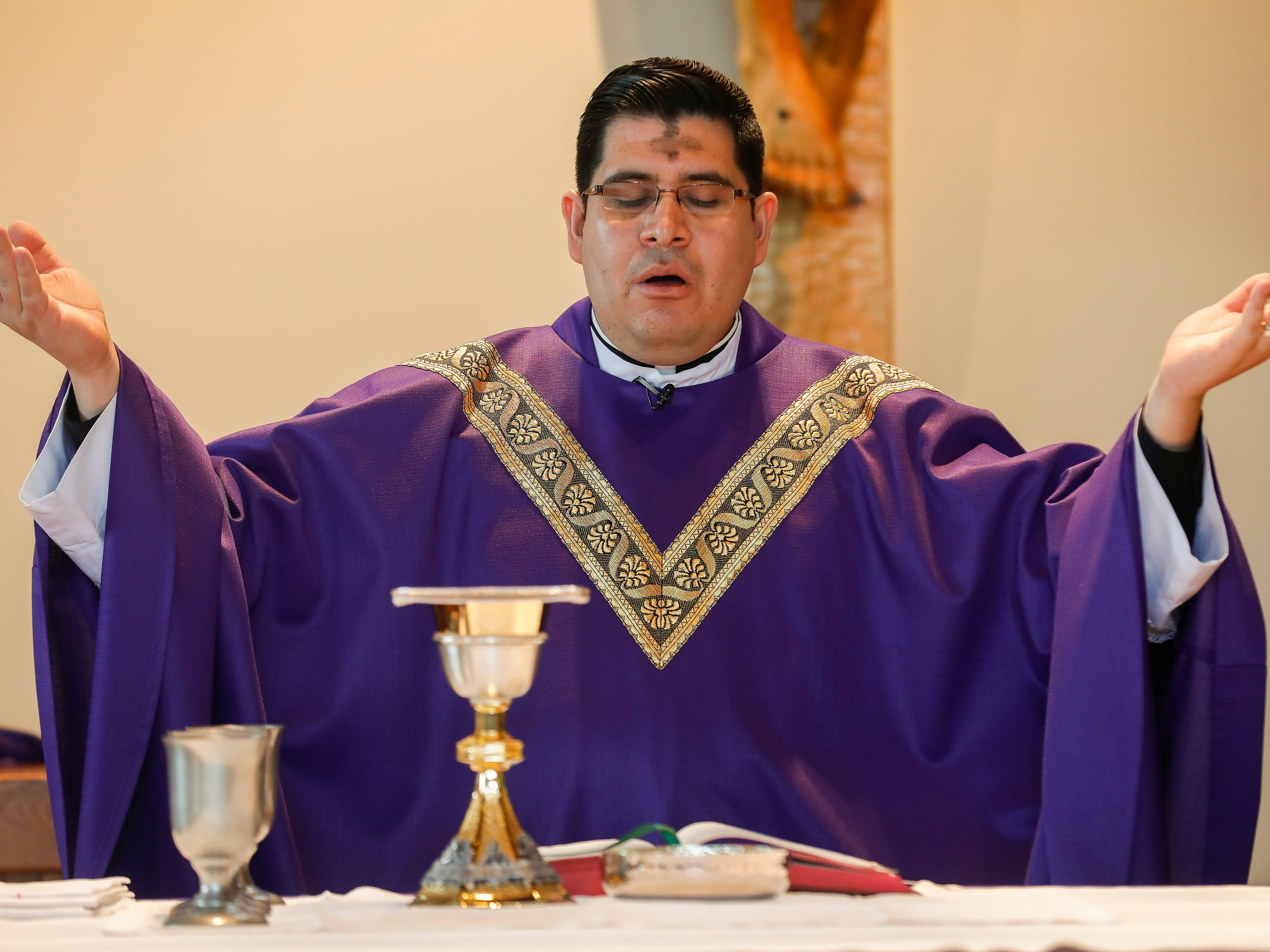 Father Javier Reyes says the Liturgy of the Eucharist during the Ash Wednesday Mass at the Missouri State University Catholic Campus Ministry on Wednesday, March 6, 2019.