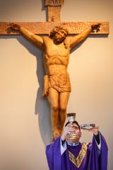 Father Javier Reyes practices the Liturgy of the Eucharist during the Ash Wednesday Mass at the Missouri State University Catholic Campus Ministry on Wednesday, March 6, 2019.