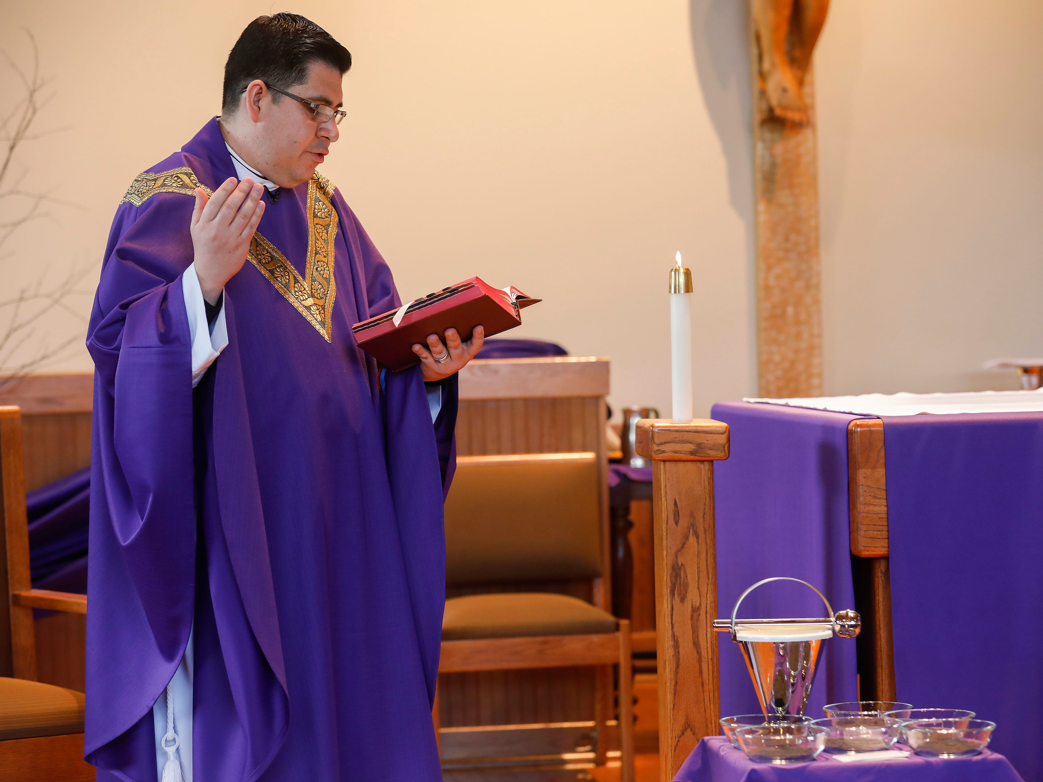 Father Javier Reyes blesses the ashes during the Ash Wednesday Mass at the Missouri State University Catholic Campus Ministry on Wednesday, March 6, 2019.