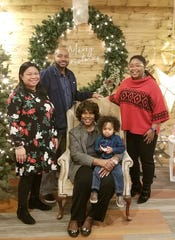 Shurita Thomas-Tate, far right, in a 2018 Christmas photo with her mother, brother, sister-in-law and nephew.