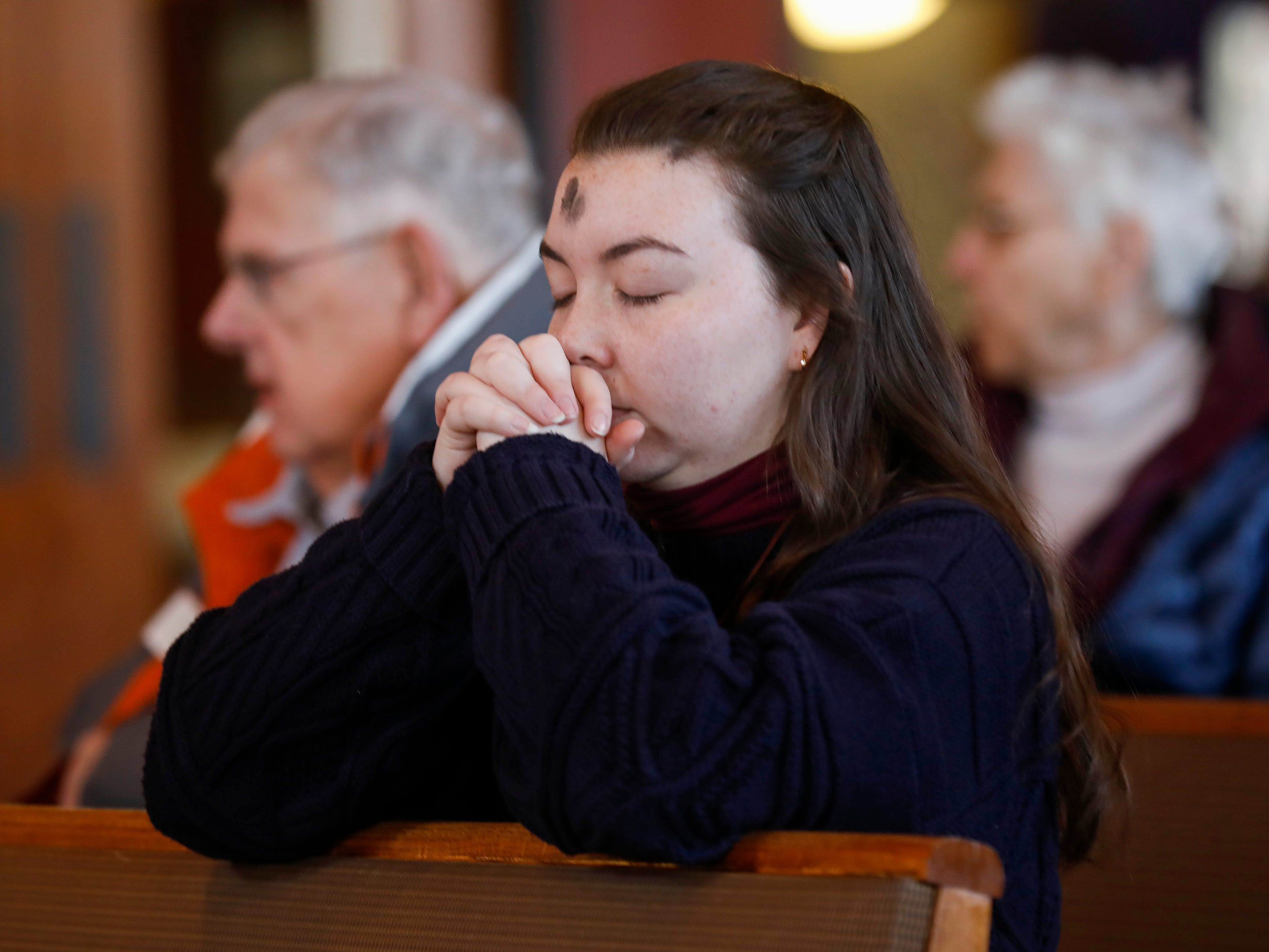 Students and other members of the community celebrate the Ash Wednesday Mass at the Missouri State University Catholic Campus Ministry on Wednesday, March 6, 2019.