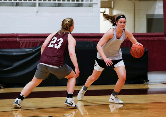 Kayley Frank guards her twin sister Hayley as they run drills during basketball practice on Tuesday, March 5, 2019.