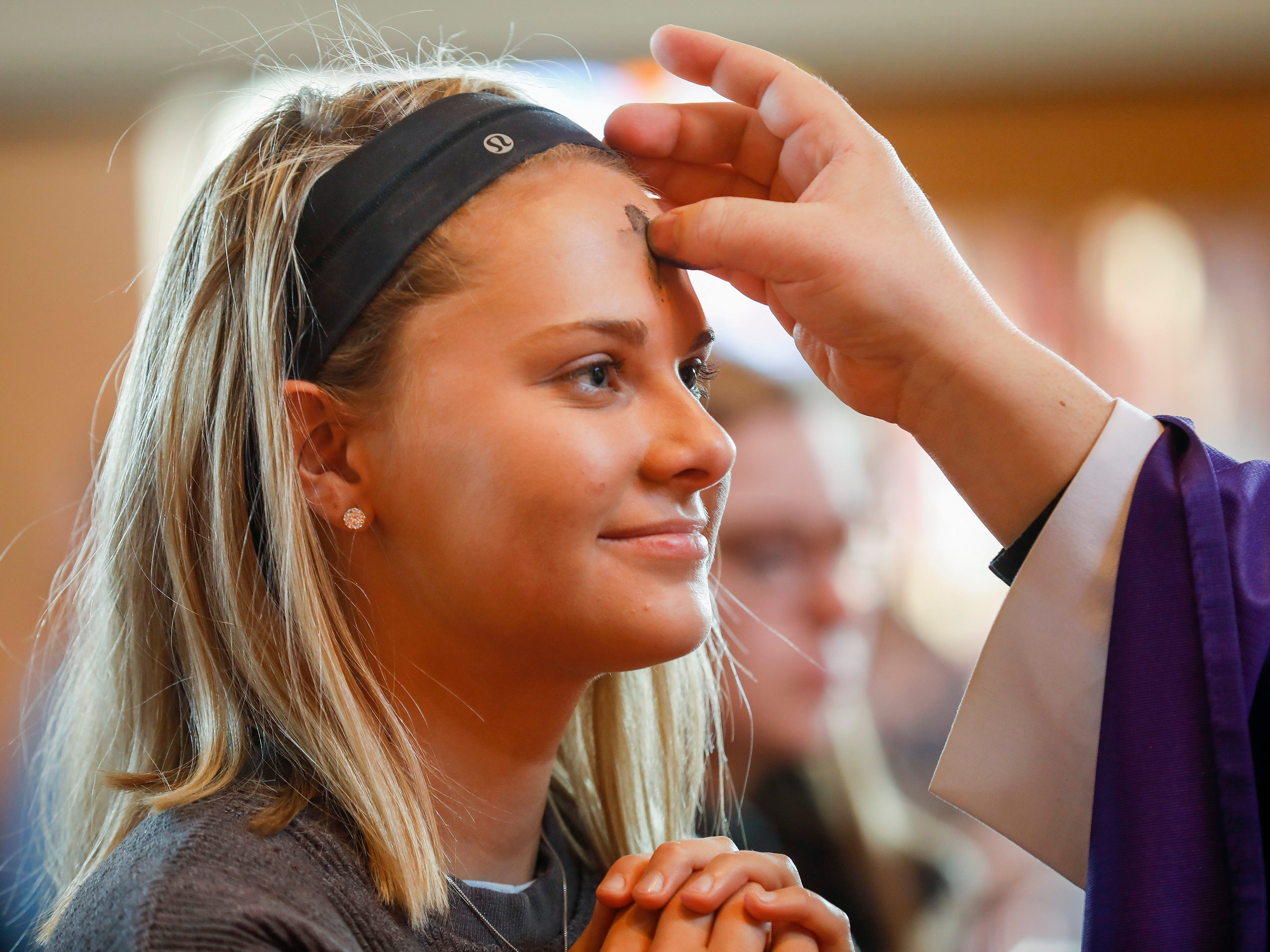 Jenna Pleimann, a student at Missouri State University, has ashes applied to her forehead during the Ash Wednesday Mass at the Missouri State University Catholic Campus Ministry on Wednesday, March 6, 2019.