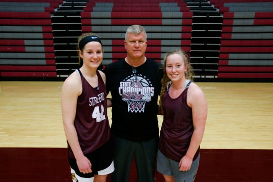 Sisters Hayley and Kayley Frank with their dad and basketball coach Steve Frank on Tuesday, March 5, 2019. The Frank family and the Strafford Lady Indians will enter Thursday night's semifinals game at JQH Arena as the three-time consecutive winners of the Class 3 state basketball tournament.