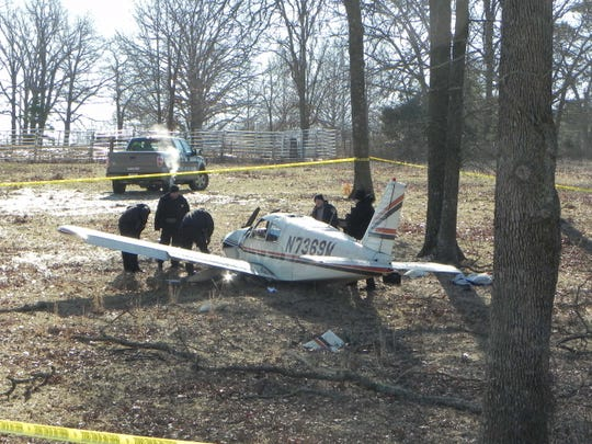 Texas County Sheriff's Department officers work at the scene of a fatal plane crash Wednesday morning about four miles west of Summersville.