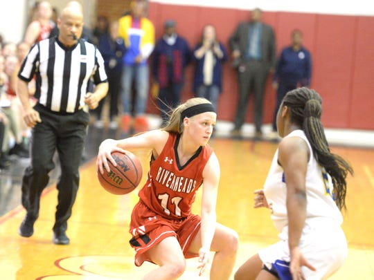 Riverheads' Sara Moore tries to find a way around the Surry County defender Tuesday in the Class 1 girls basketball state semifinals.