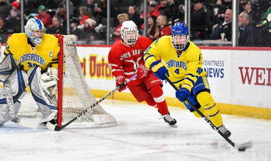 Cathedral's Jon Bell controls the puck during the first period of the Minnesota Boys Hockey Tournament Class A quarterfinals Wednesday, March 6, at the Xcel Energy Center in St. Paul.