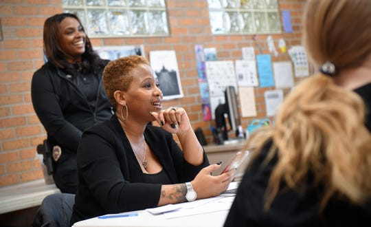 KoriAnn Carter and Talishia Barlow talk with members of the GOATS, Girls On Arise To Succeed, program Wednesday, Feb. 27, at Roosevelt Boys & Girls Club in St. Cloud.