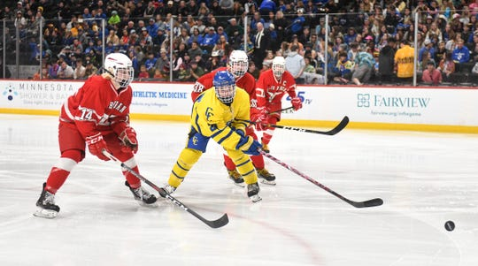 Cathedral's Blake Perbix is surrounded by North Branch players during the Minnesota Boys Hockey Tournament Class A quarterfinals Wednesday, March 6, at the Xcel Energy Center in St. Paul.
