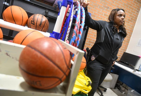 Talishia Barlow of the St. Cloud Police Department talks about her work with the GOATS, Girls On Arise To Succeed, program Wednesday, Feb. 27, at Roosevelt Boys & Girls Club in St. Cloud.