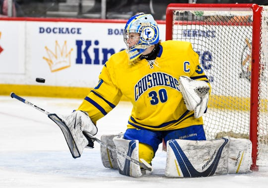 Cathedral goaltender Noah Amundson makes a save during the Minnesota Boys Hockey Tournament Class A quarterfinals Wednesday, March 6, at the Xcel Energy Center in St. Paul.
