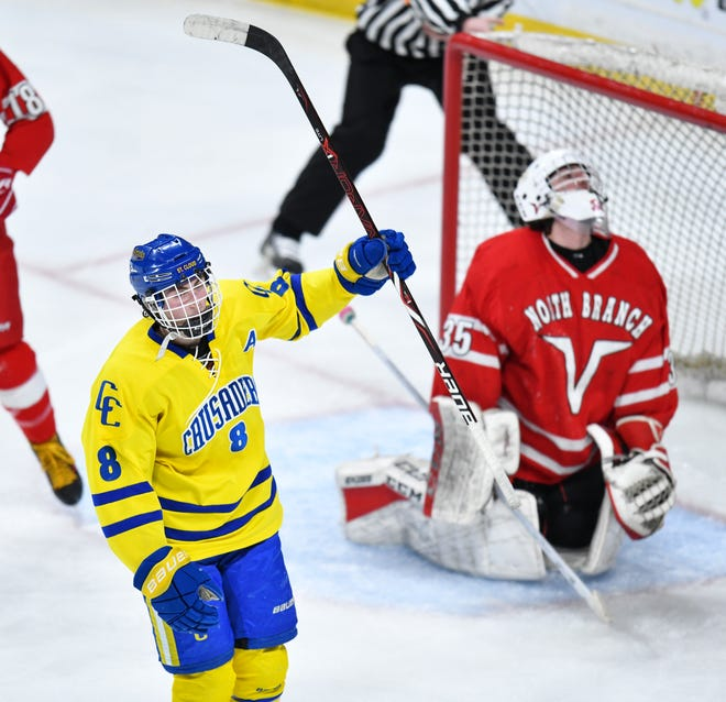 Cathedral's Nate Warner celebrates one of his three second period goals during the Minnesota Boys Hockey Tournament Class A quarterfinals Wednesday, March 6, at the Xcel Energy Center in St. Paul.