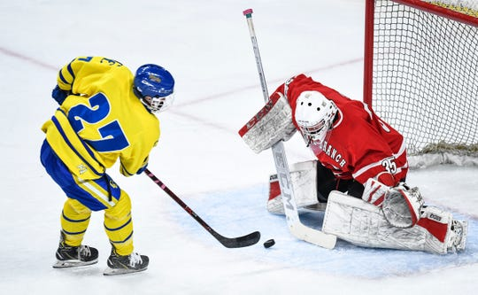 Cathedral's Blake Perbix takes a shot on North Branch goaltender Jake Turek during the Minnesota Boys Hockey Tournament Class A quarterfinals Wednesday, March 6, at the Xcel Energy Center in St. Paul.